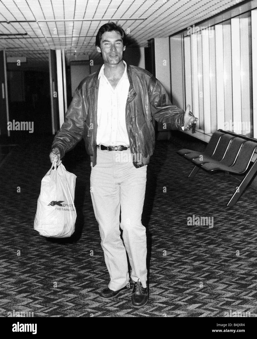 Timothy Dalton actor who stars in the film The Living Daylights arrives at Heathrow airport from Miami September - Stock Image