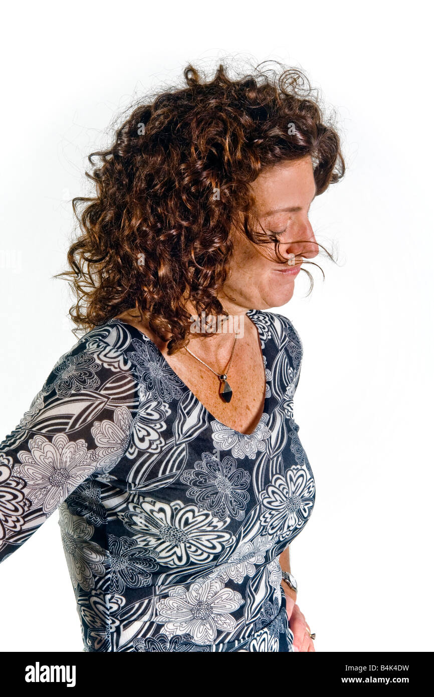 A woman s gesture of looking down with face turned away indicates disbelief in body language terms - Stock Image