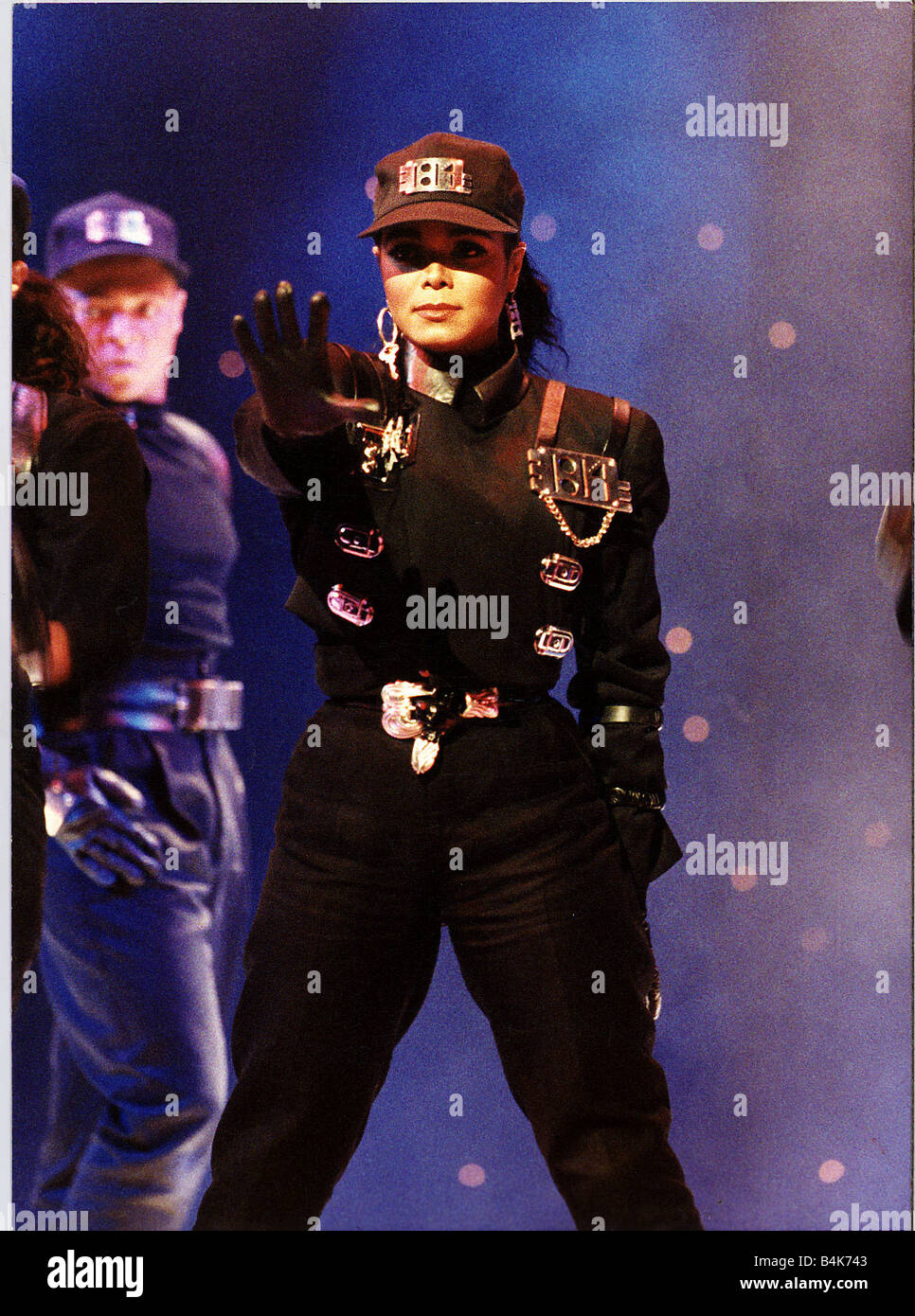 Janet Jackson on stage right arm outstretched Wearing baseball cap dbase  1989 4d1b10010c7