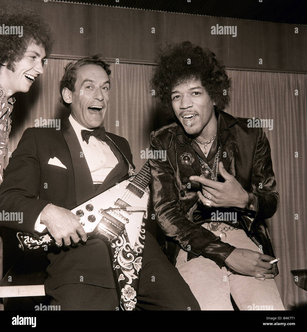 Jeremy Thorpe with Jimi Hendrix after concert by The Jimi Hendrix Experience at Royal Festival Hall guitar tuxcedo Stock Photo