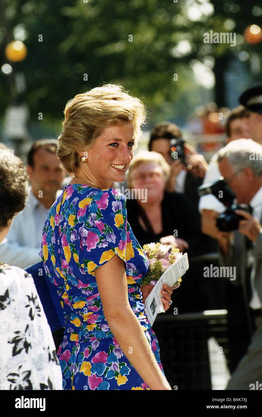 Princess Diana In Blue Dress With Flower Pattern Holding Bouquet Of