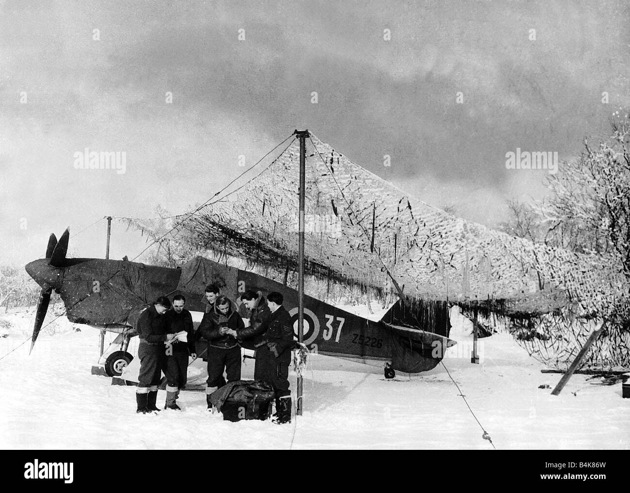 An RAF Hurricane in a snow covered field in Russia during WW2 1942 - Stock Image