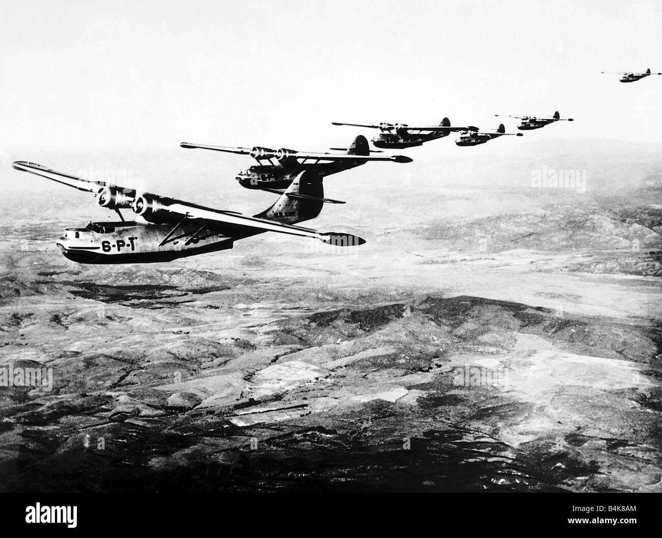 A flight of Consolidated Catalina flying boats of the US Navy flying in formation as used in WW2 1938 - Stock Image