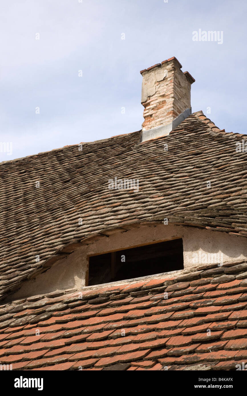 Sibiu Transylvania Romania Europe Eyes of Sibiu on tiled roof of old historic building with eye window Stock Photo