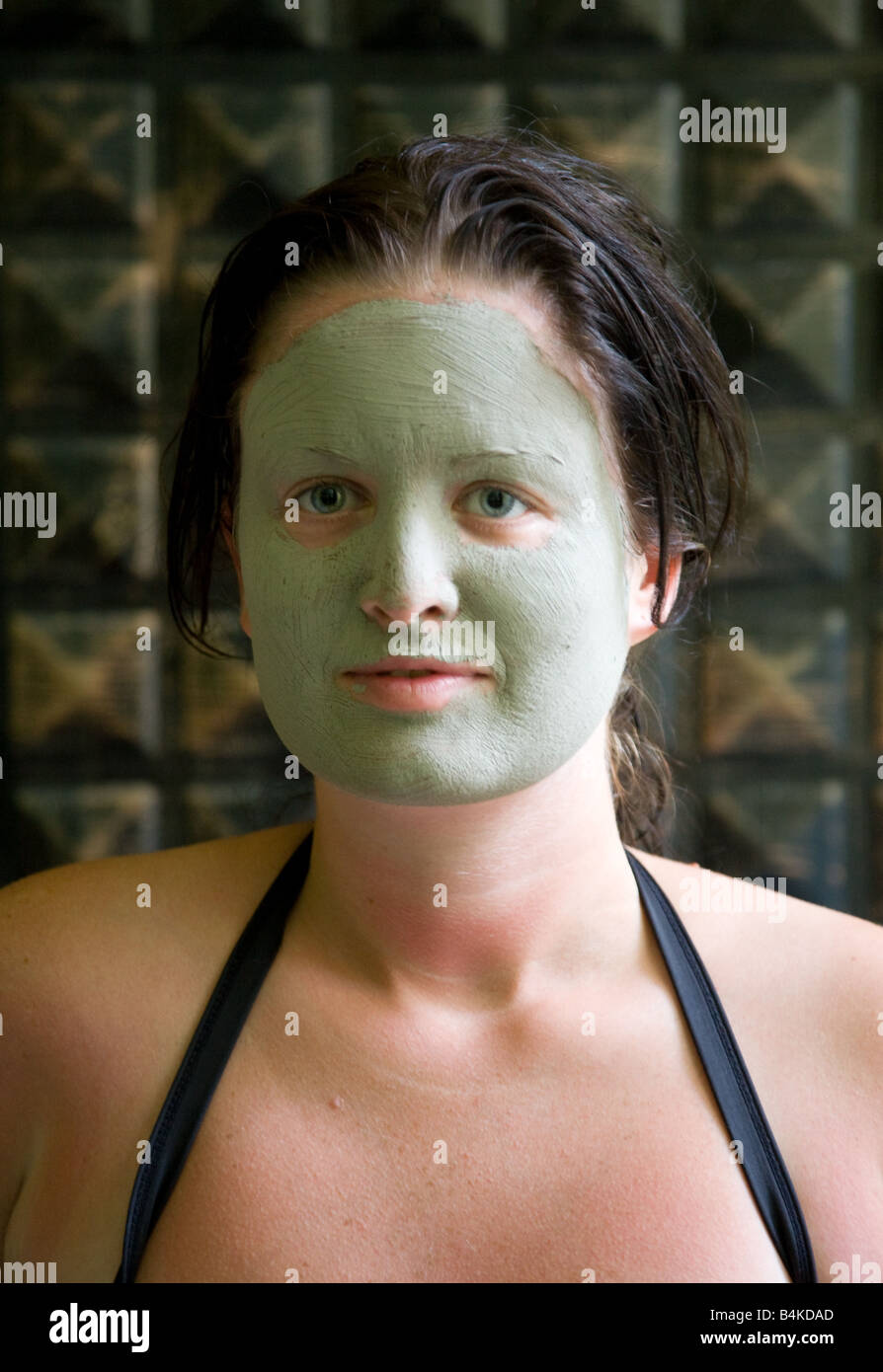 Young woman with a face mask - Stock Image