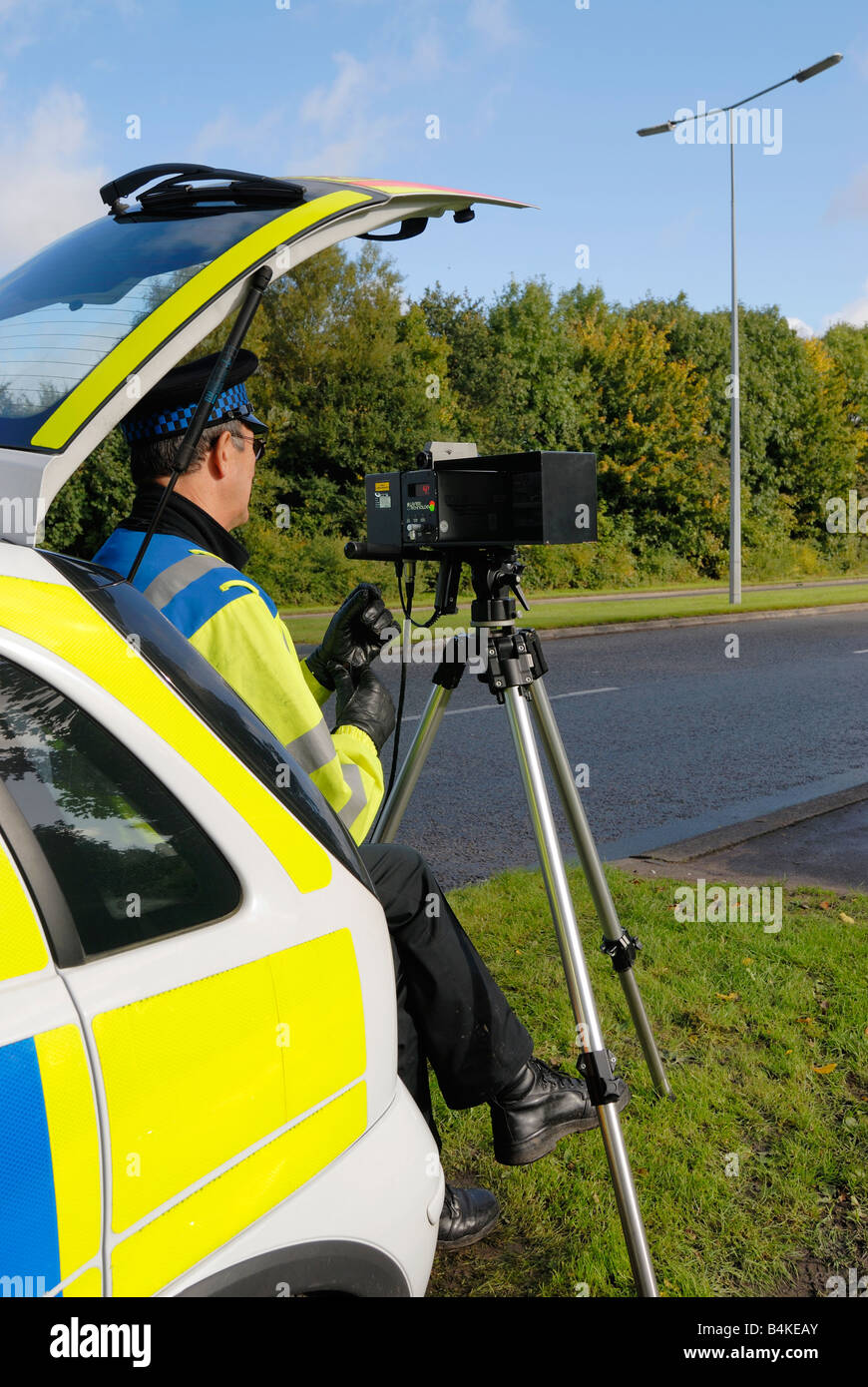British traffic policeman operating a laser speed camera Stock Photo
