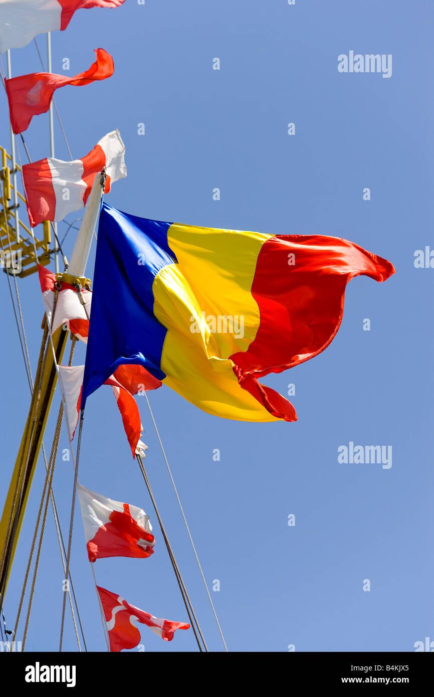 flags on Mircea tall ship - Stock Image