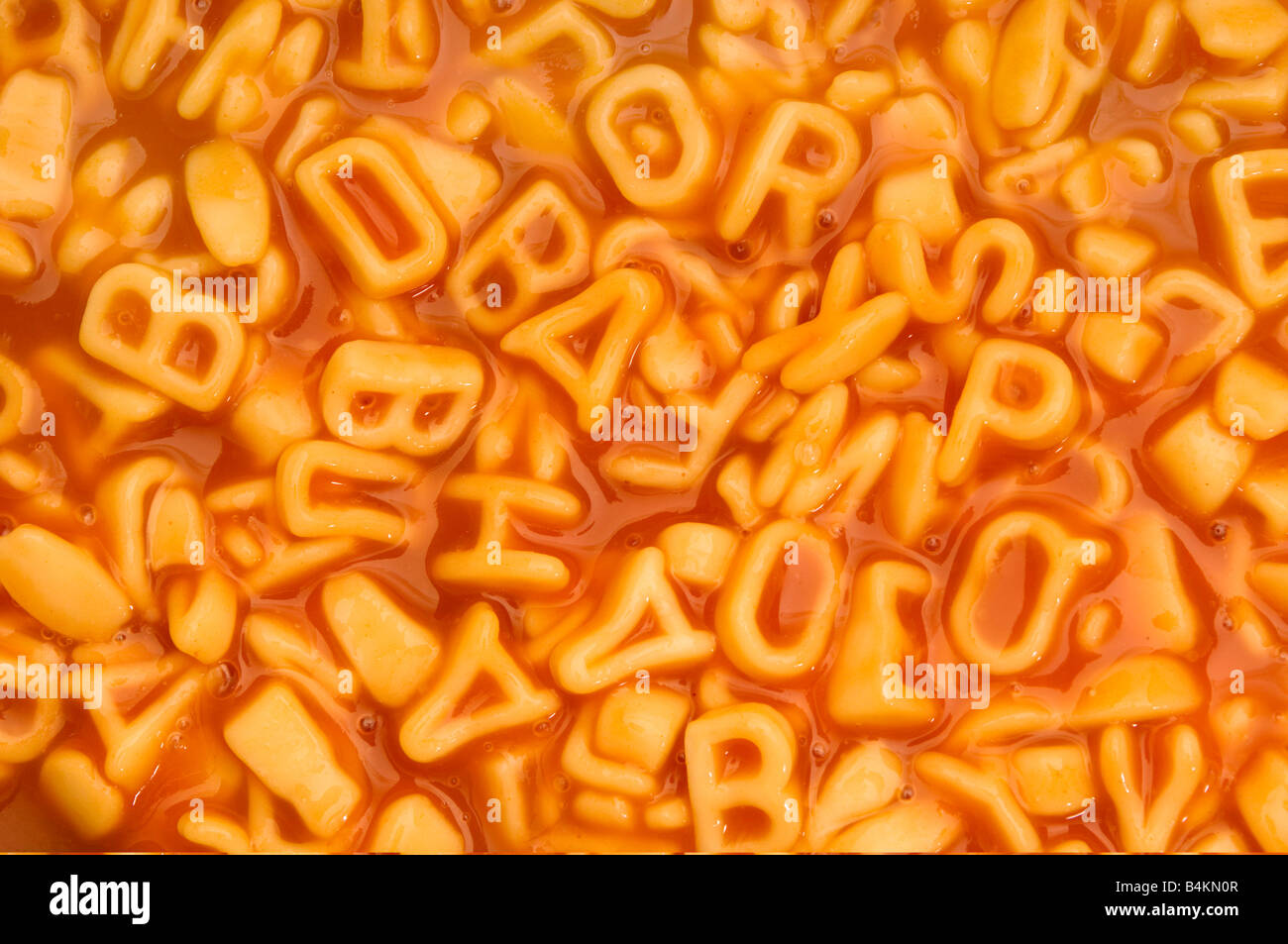 a background of alphabet spaghetti - Stock Image