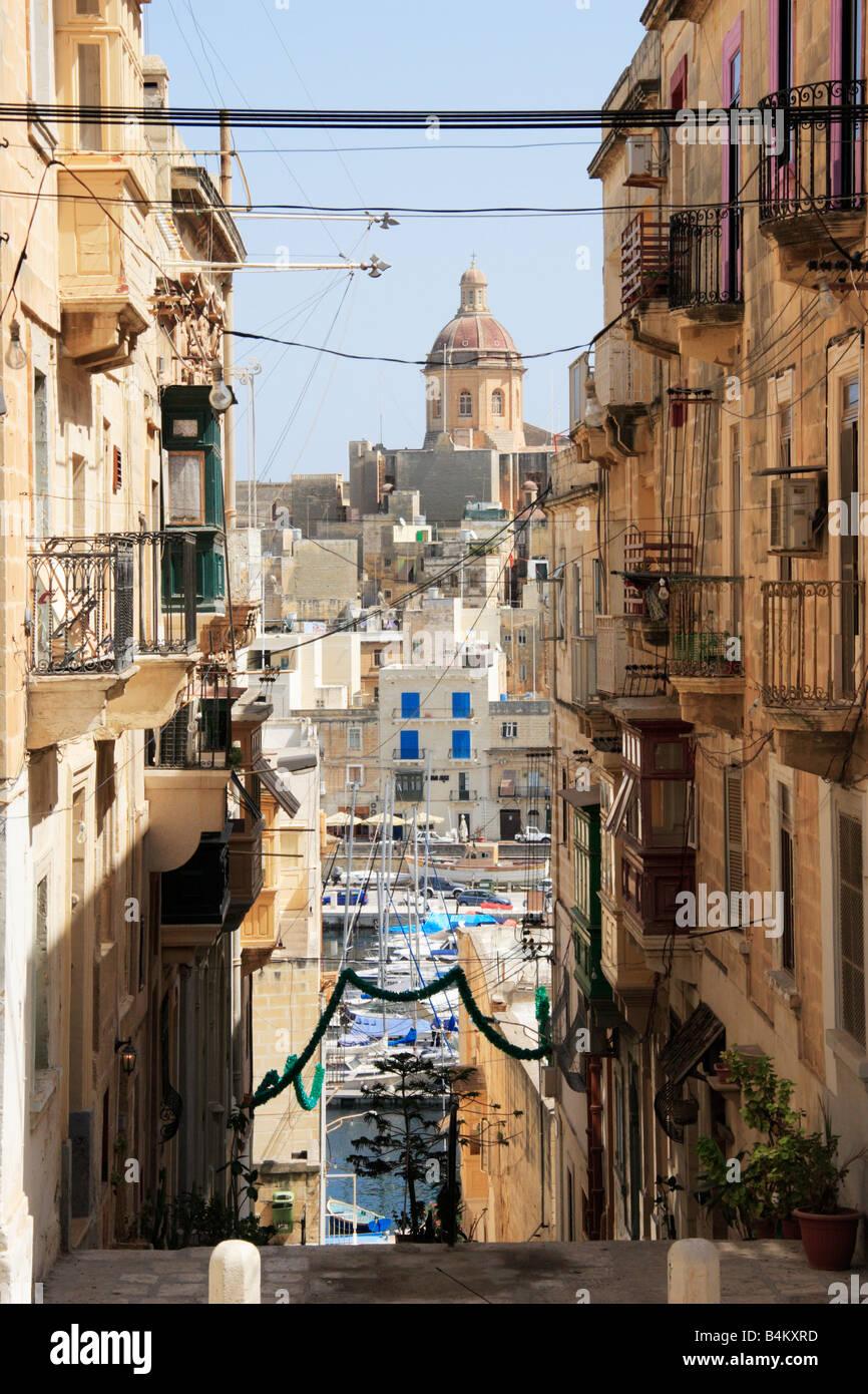 'Triq Il Macina', a typical street in Senglea, Malta. - Stock Image