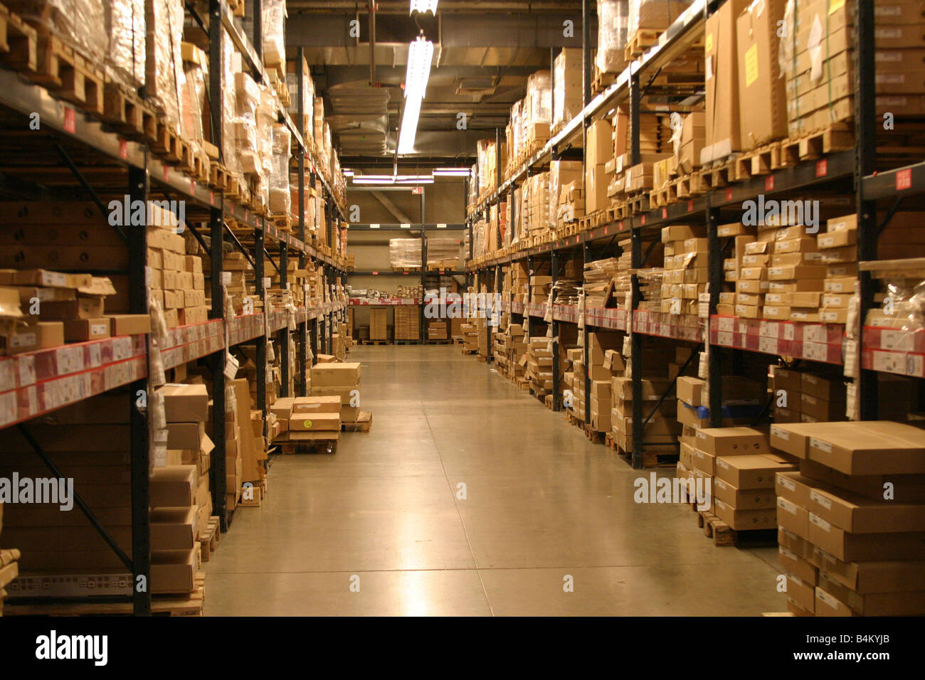 packages lining shelves in a warehouse Stock Photo
