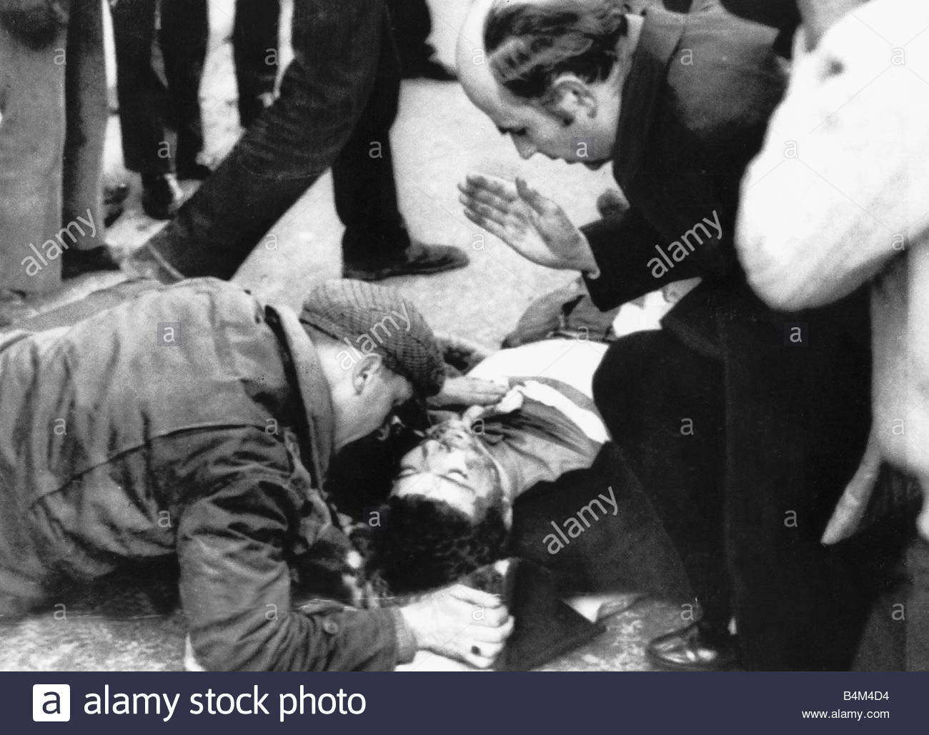 A priest gives last rites to a boy injured in the Bloody Sunday riots in Derry N Ireland 30 January 1972 saw one - Stock Image
