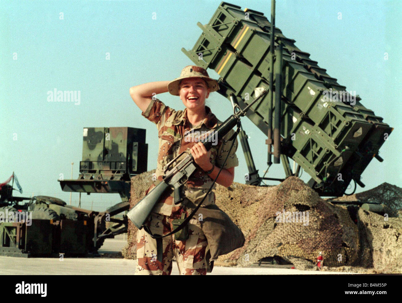 Gulf War Operation Desert Storm American Patriot defence missile system guarded by female soldier The new face of - Stock Image