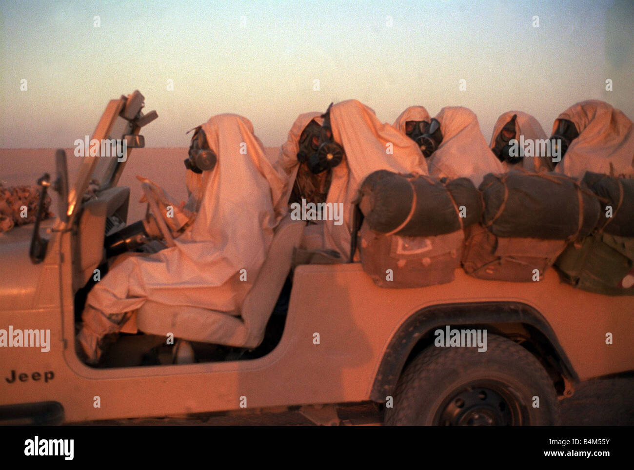 Gulf War Operation Desert Storm Egyptian SAS Soldiers wearing gas masks sitting fully equiped in back of jeep These - Stock Image