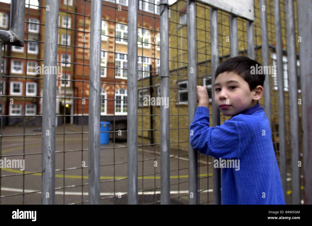 Schools closed today due to teachers demonstrating in london Bili Iwai aged 8 outside the Addison Road primary school - Stock Image