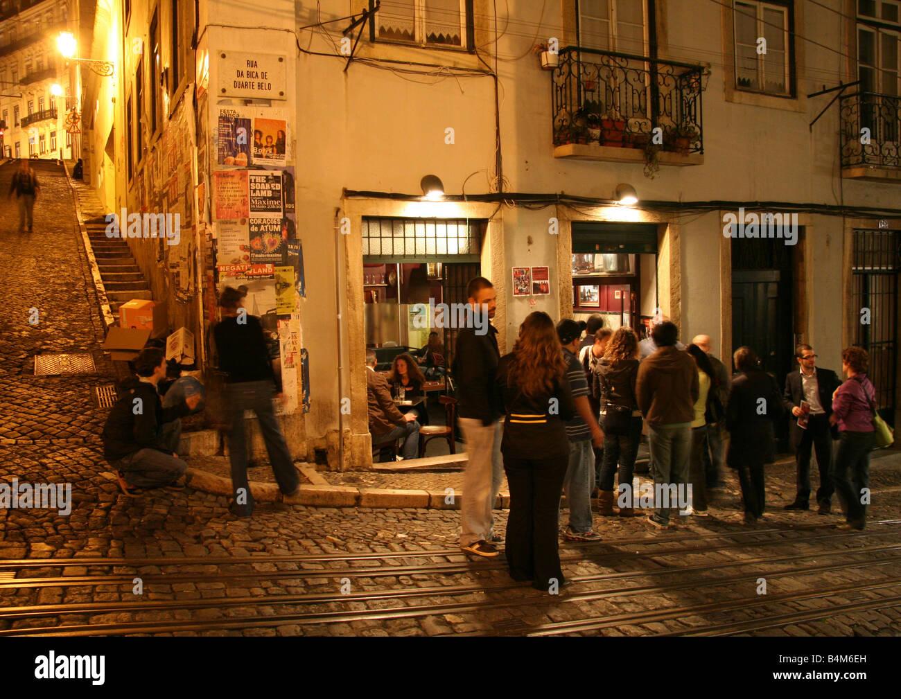 Bar crawl in Bairro Alto infront of Bicaense - Stock Image