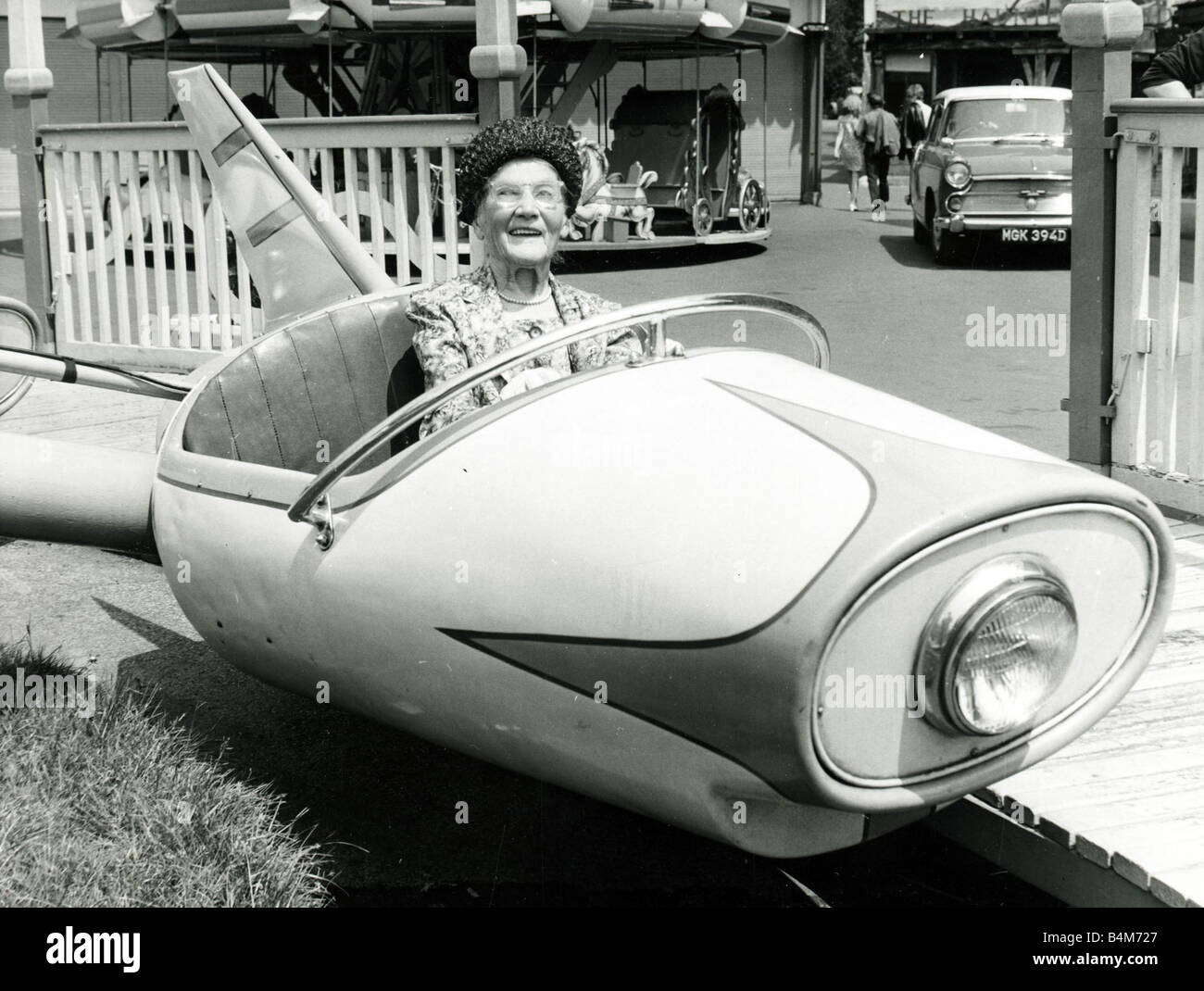 Old age pensioner Ellen Pert 101 years old rides in a fairground dive bomber car ride 1966 - Stock Image
