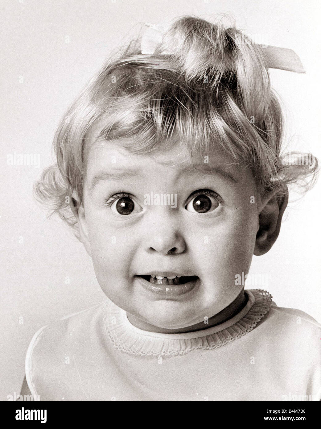 Little girl with her eyes wide open circa 1970 - Stock Image