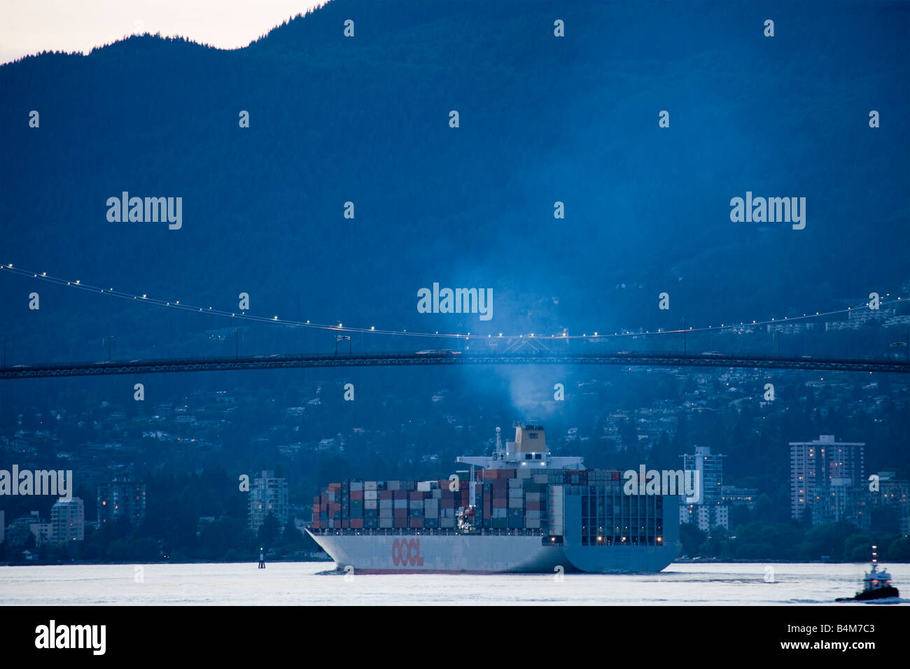 OOCL Netherlands container ship passing under Lion's Gate bridge, Vancouver,  British Columbia, Canada - Stock Image