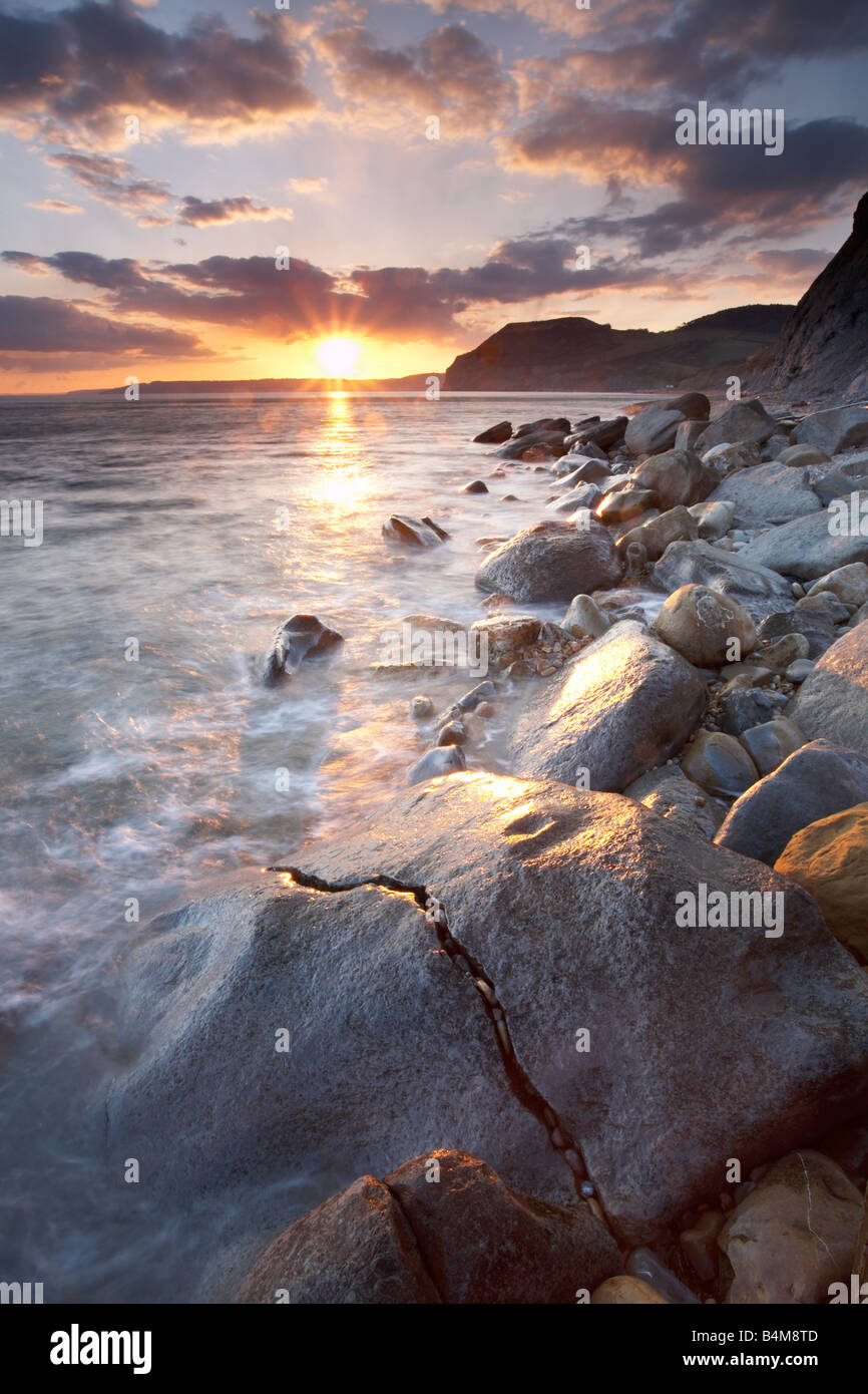 The Jurassic coast at sunset with 'Golden Cap' in the distance, Dorset, England, UK Stock Photo