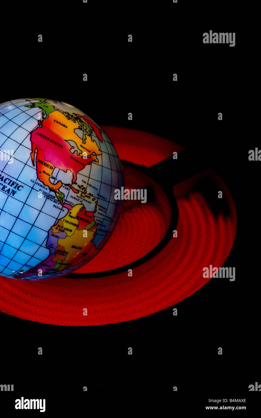 A globe is shown beon top of a hot stove burner representing the concept of Global Warming - Stock Image