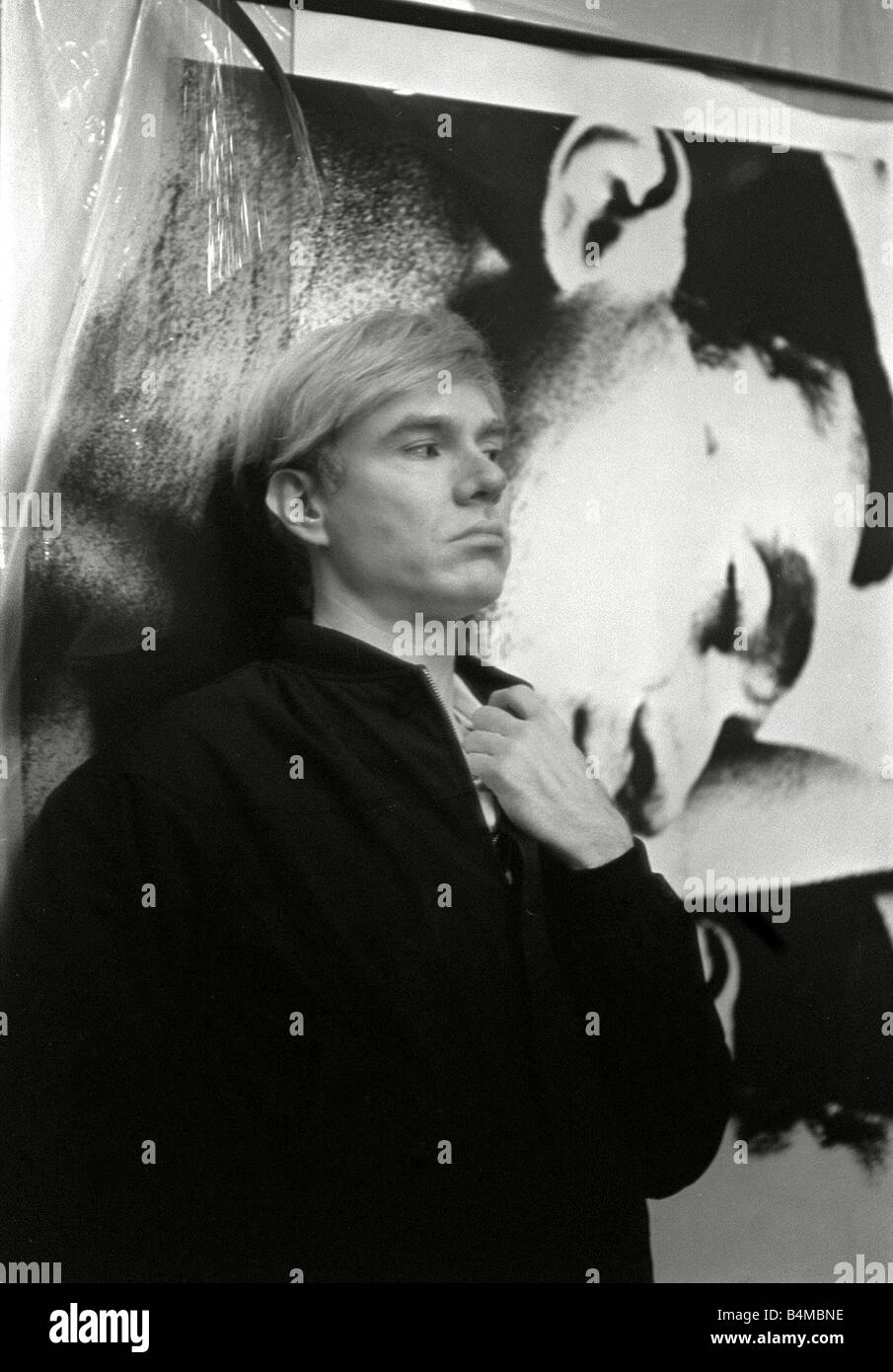 Andy Warhol Film maker leader of the Pop Art Underground in his studio In front of one of his prints 1965 - Stock Image