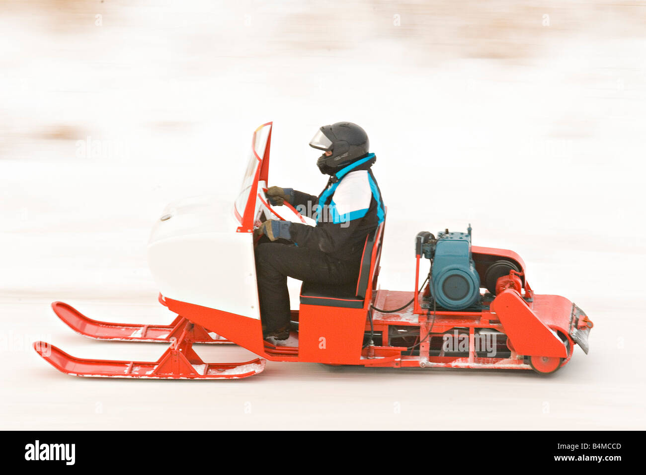 Vintage snowmobiles parade at the I 500 Snowmobile race in