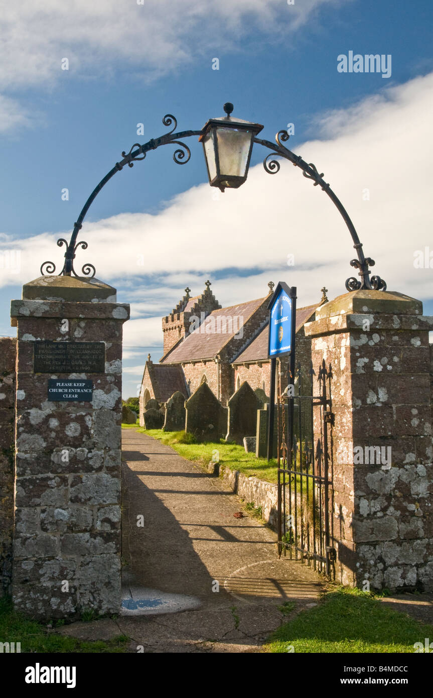 Llanmadoc Church in Gower South Wales through the arch of the churchyard gateway archway. - Stock Image
