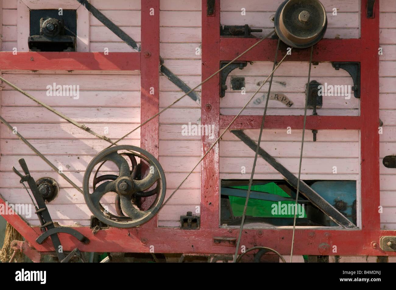 Detail of old belt driven threshing machine, - Stock Image