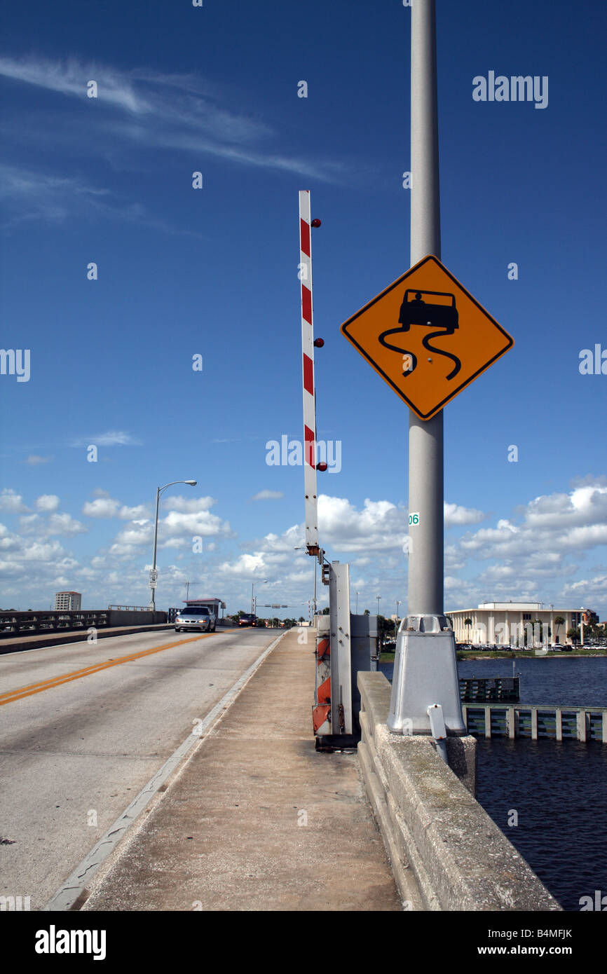 Slippery When Wet Warning sign on the Silver Beach bridge in Daytona Beach, FL.. - Stock Image