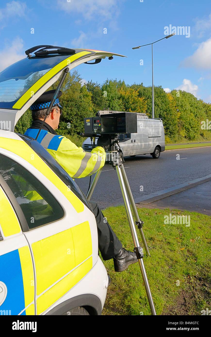 British traffic policeman operating a laser speed camera Stock Photo