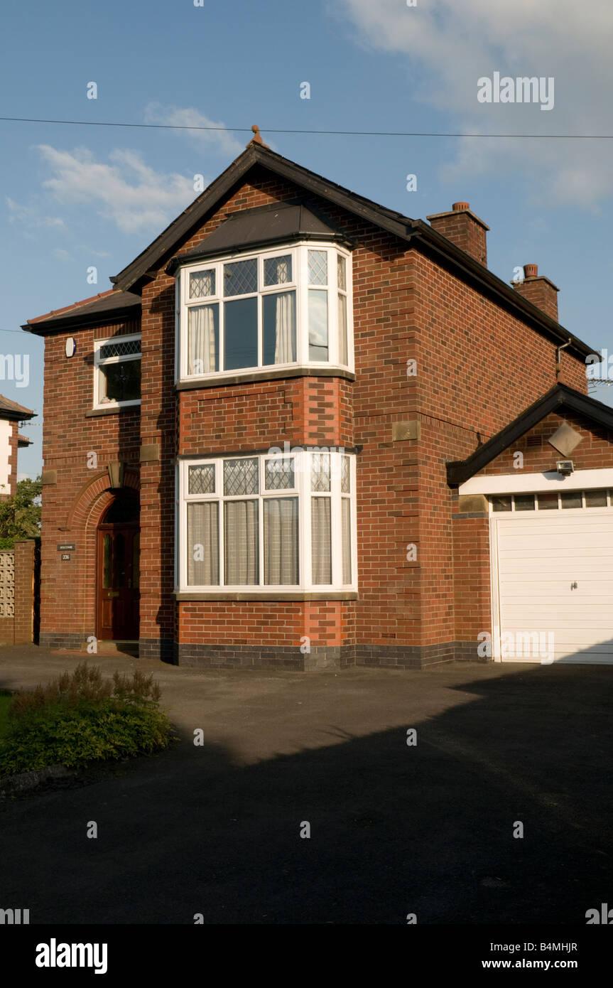 Detached 1930s red brick suburban town house Preston Lancashire Englamd UK - Stock Image