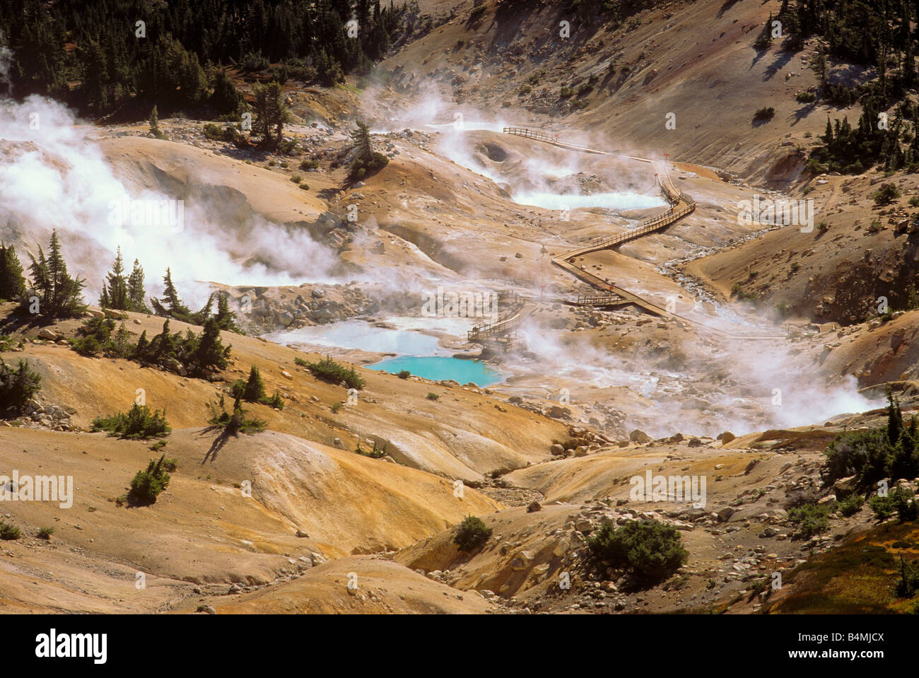 Steam rising from the Bumpass Hell geothermal area Cascade Mountains Pacific Lassen Volcanic National Park California - Stock Image