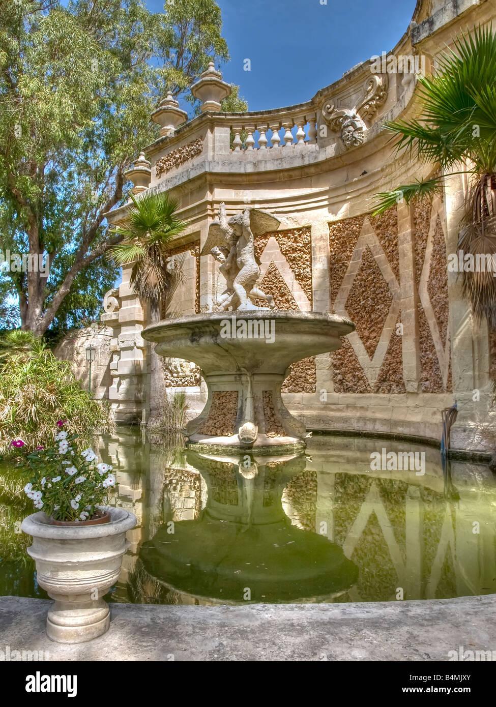 A medieval fountain in a public garden in Malta Stock Photo ...
