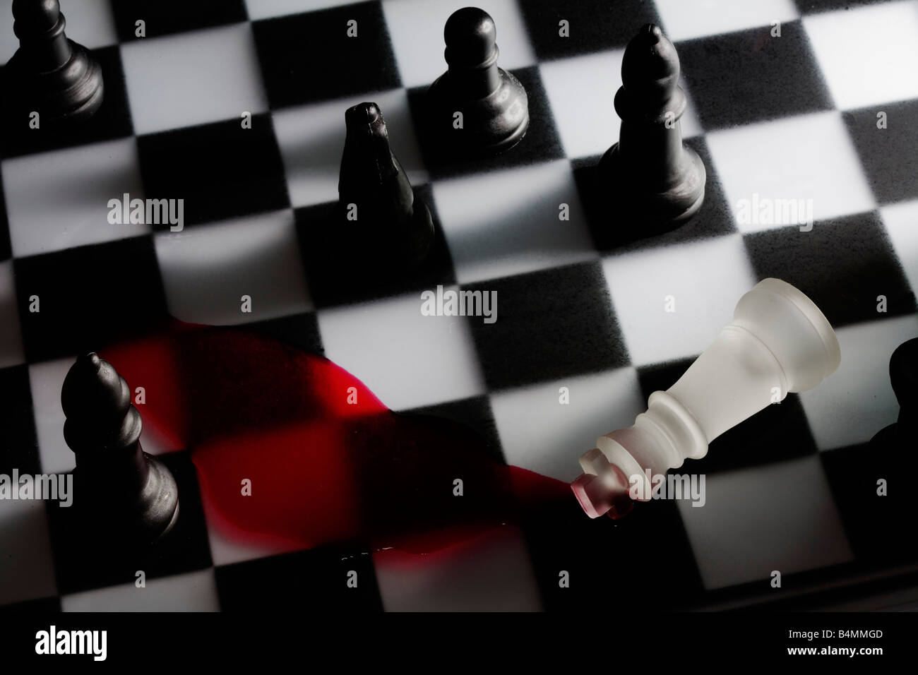 The King is toppled in a game of Chess - Checkmate - Stock Image