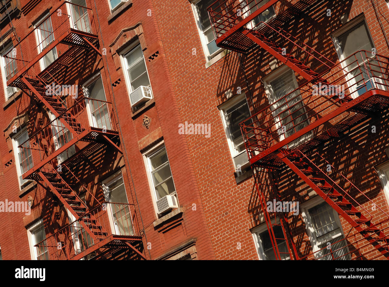 A New York neighborhood brick apartment as viewed from the street. Stock Photo