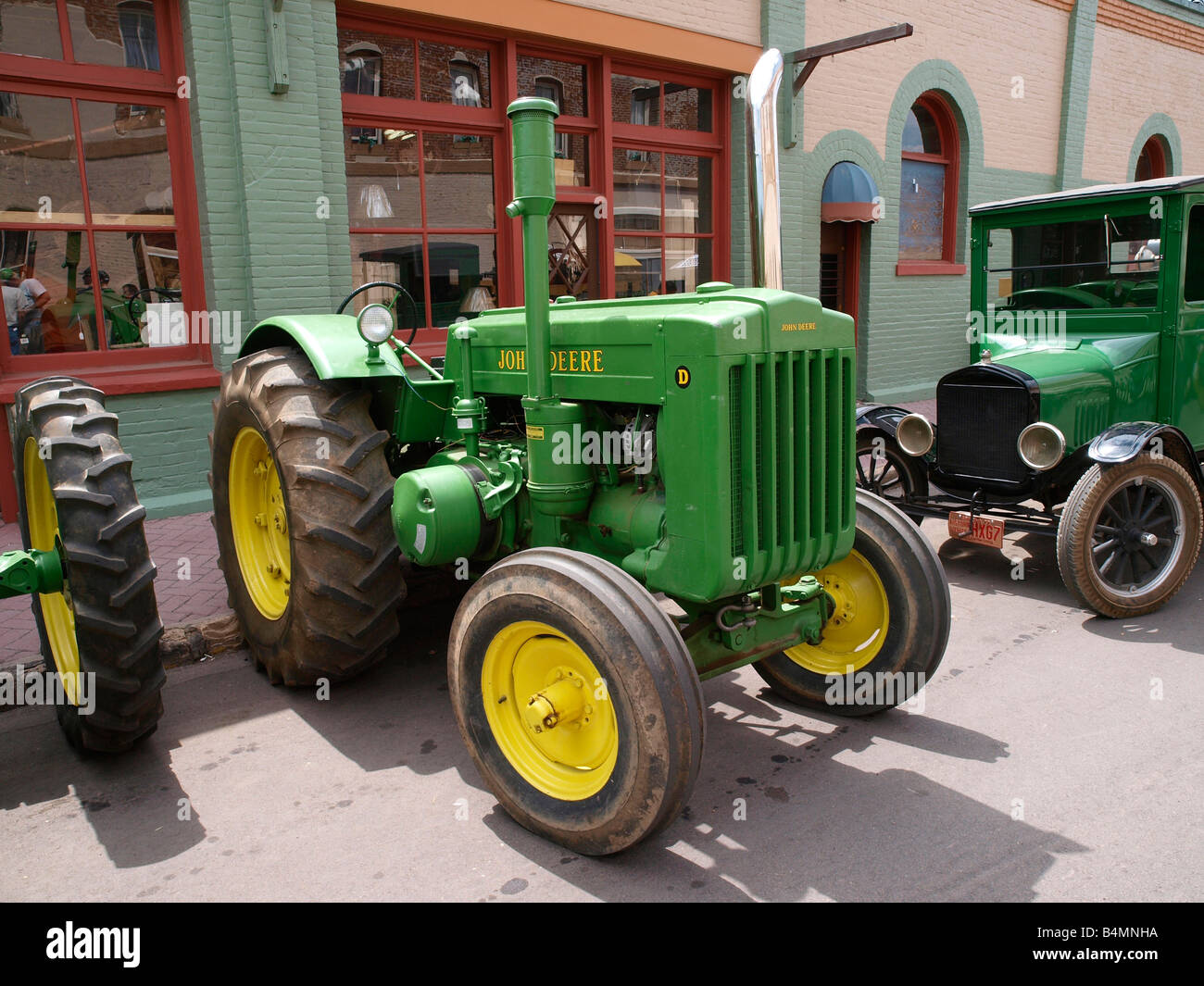 John Deere Model D Tractor together with other classic tractors decked out for the 4th July Parade Williams AZ US - Stock Image
