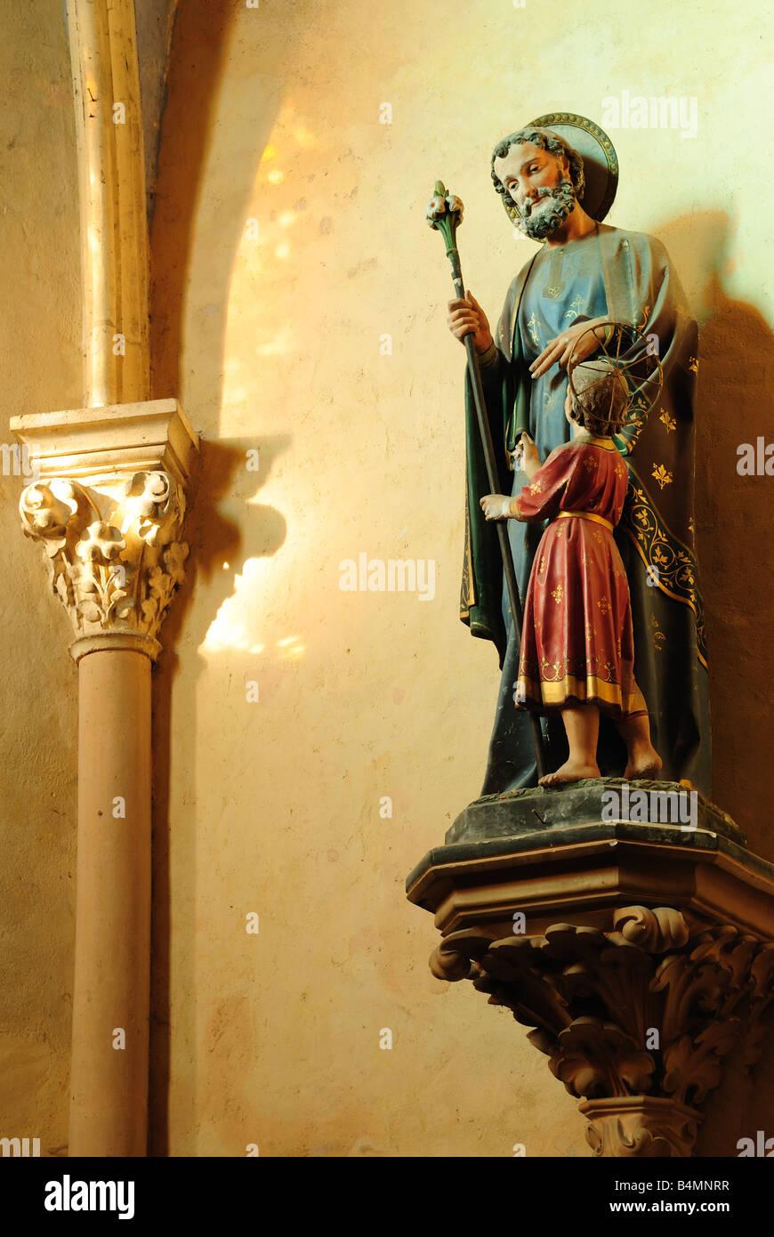 Painted statue of saint at Castelfranc Midi Pyrénées France - Stock Image