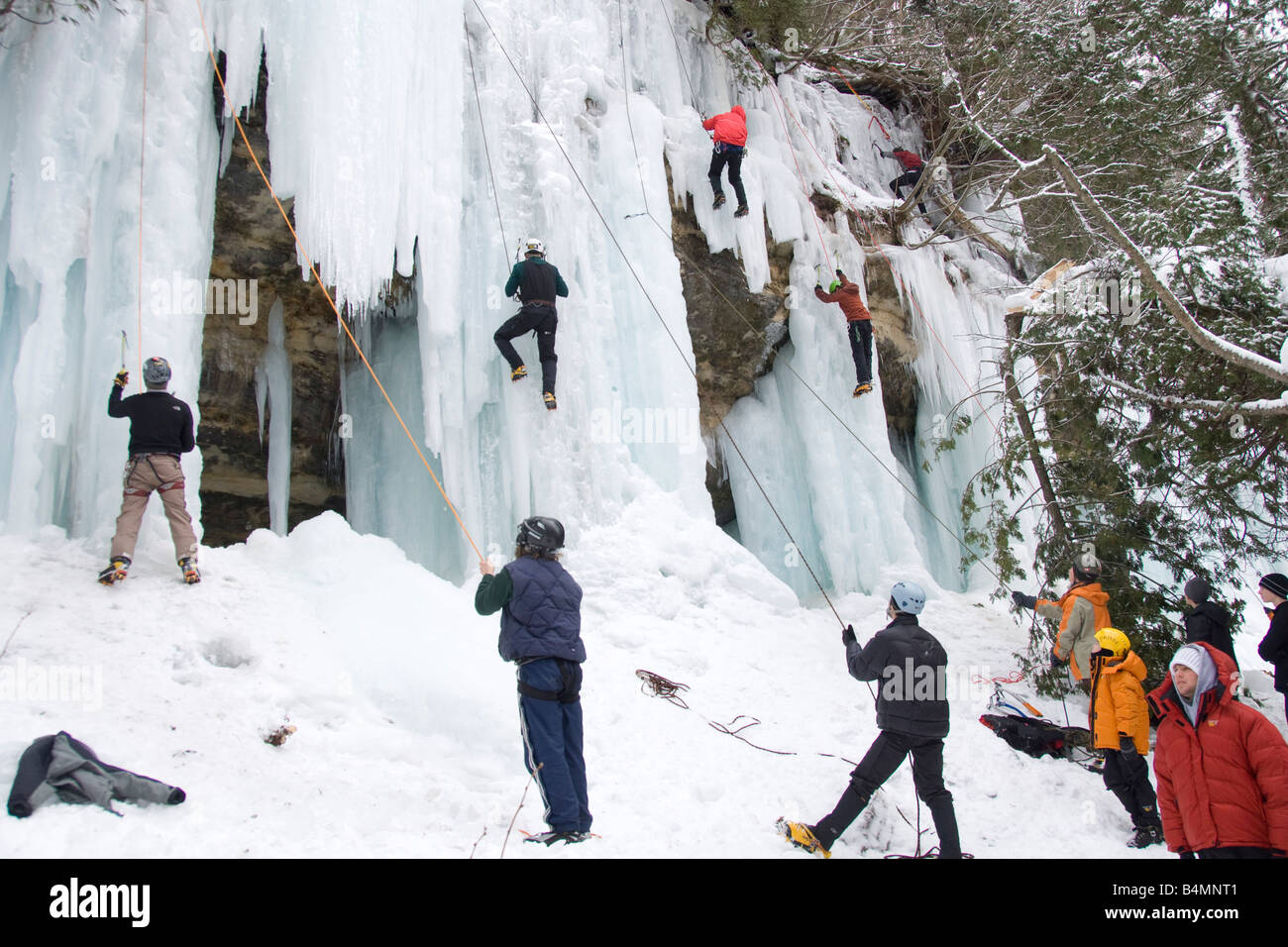 Ice climbing during Michigan Ice Fest at Pictured Rocks National Lakeshore in Munising Michigan Upper Peninsula Stock Photo