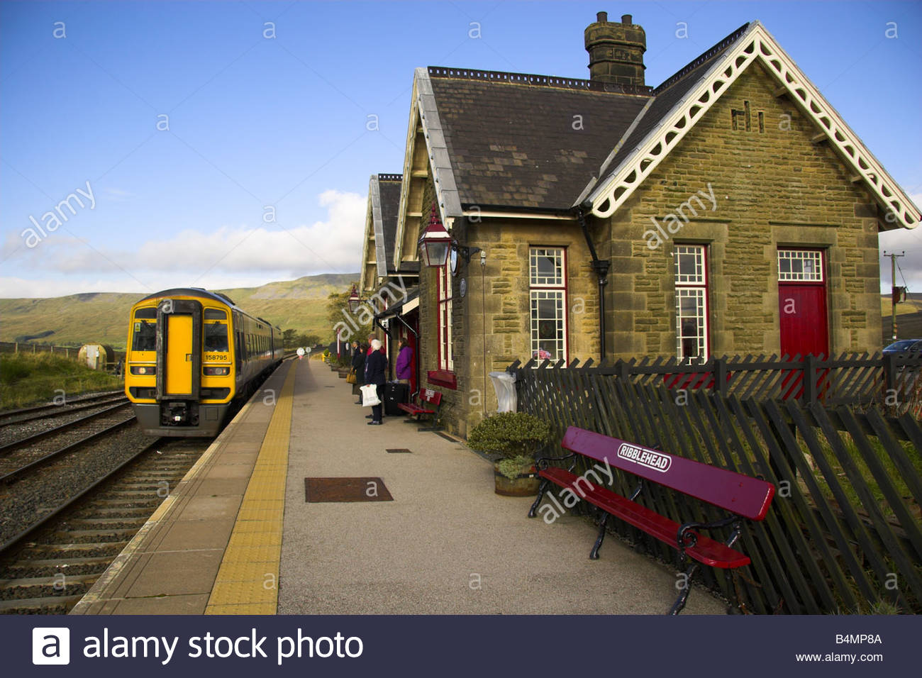 A Carlisle to Leeds train arrives at Ribblehead Station, North Yorkshire, England. - Stock Image