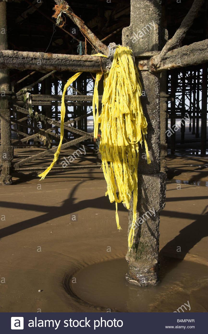 Coastal plastic debris, wrapped around a pier leg. Blackpool, Lancashire, UK. - Stock Image