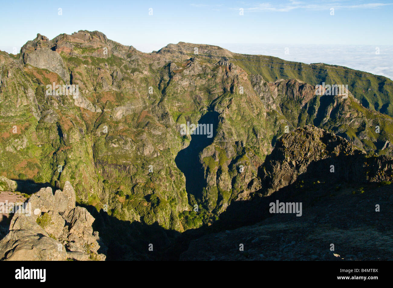 View from Pico do Areeiro Madeira towards Pico das Torres and distant Pico Ruivo the island s highest summit - Stock Image