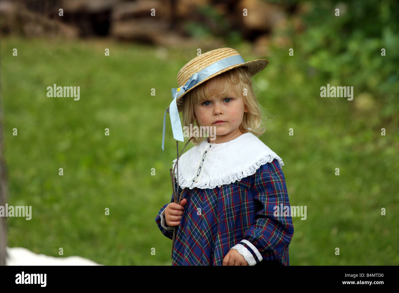 A little girl dressed up in civil war 1860 period clothling - Stock Image
