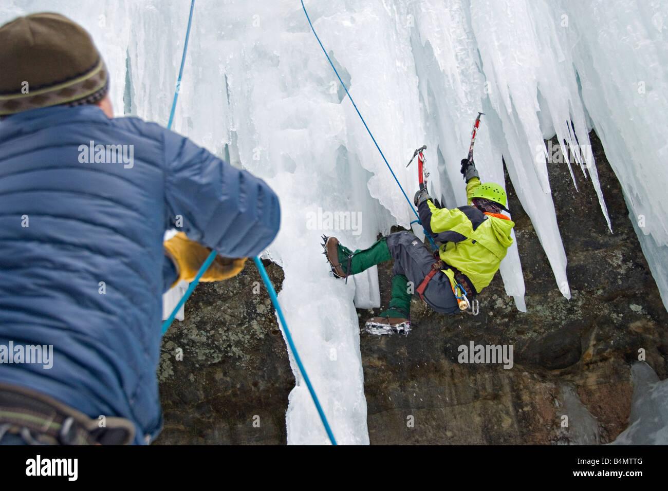 Ice climbing during Michigan Ice Fest at Pictured Rocks National Lakeshore in Munising Michigan Upper Peninsula Stock Photo