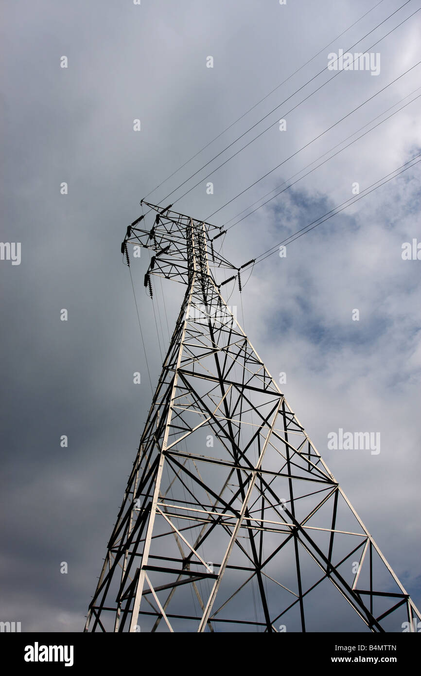 High voltage power lines from a power Plant to a city - Stock Image