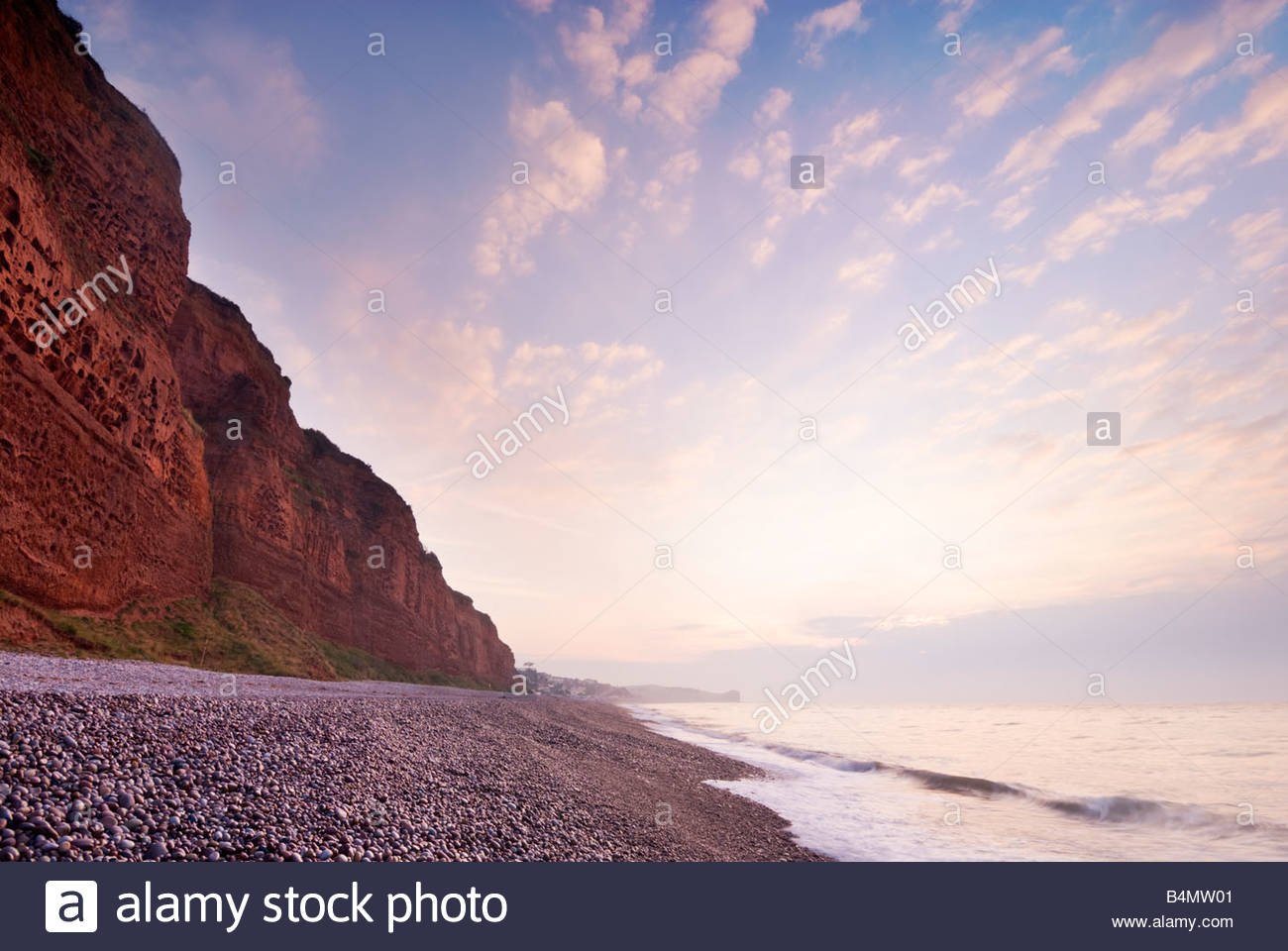 The beach at Budleigh Salterton, East Devon, at sunrise. - Stock Image