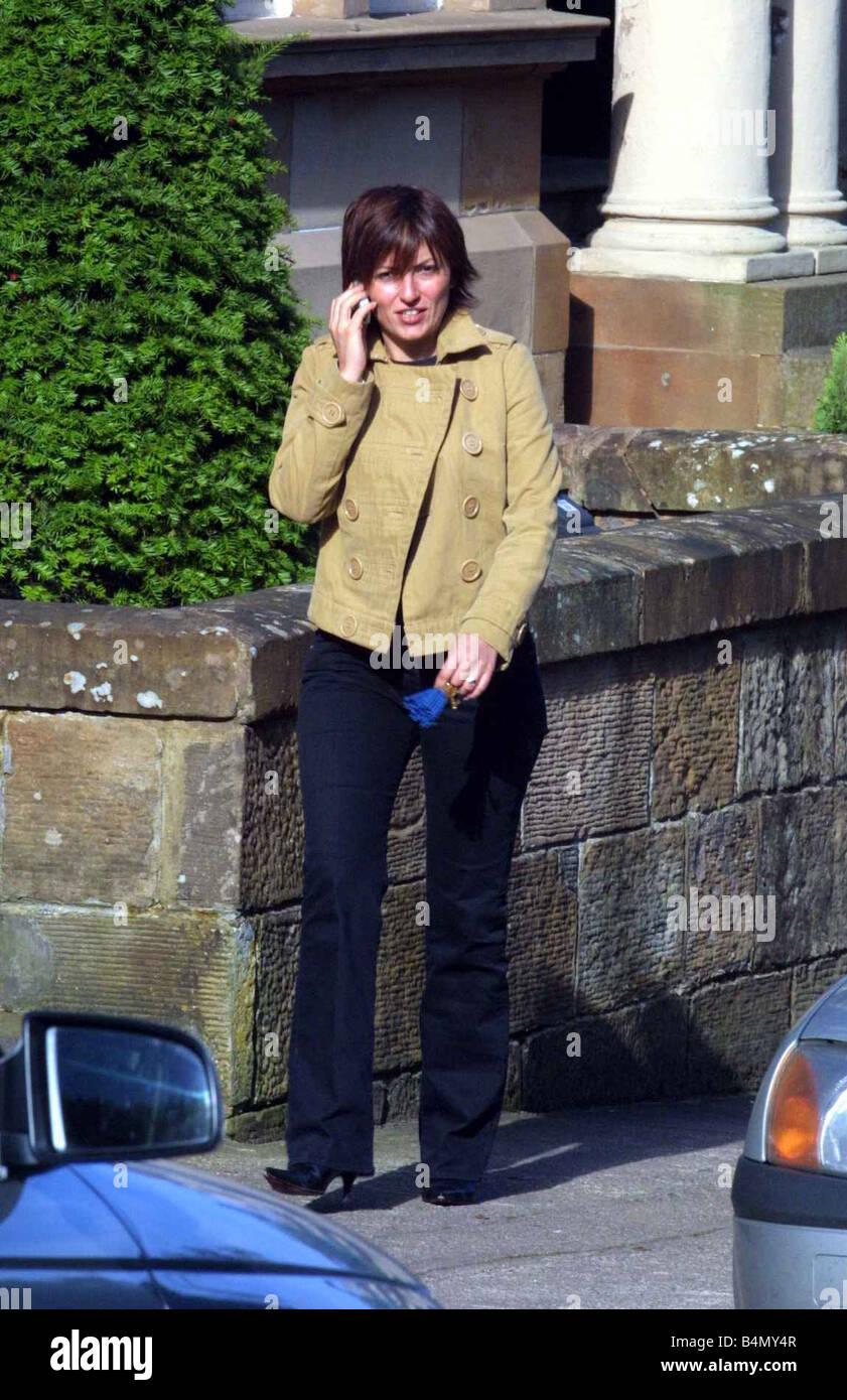 Davina McCall leaving Devonshire Gardens Glasgow August 2002 talking on mobile phone - Stock Image