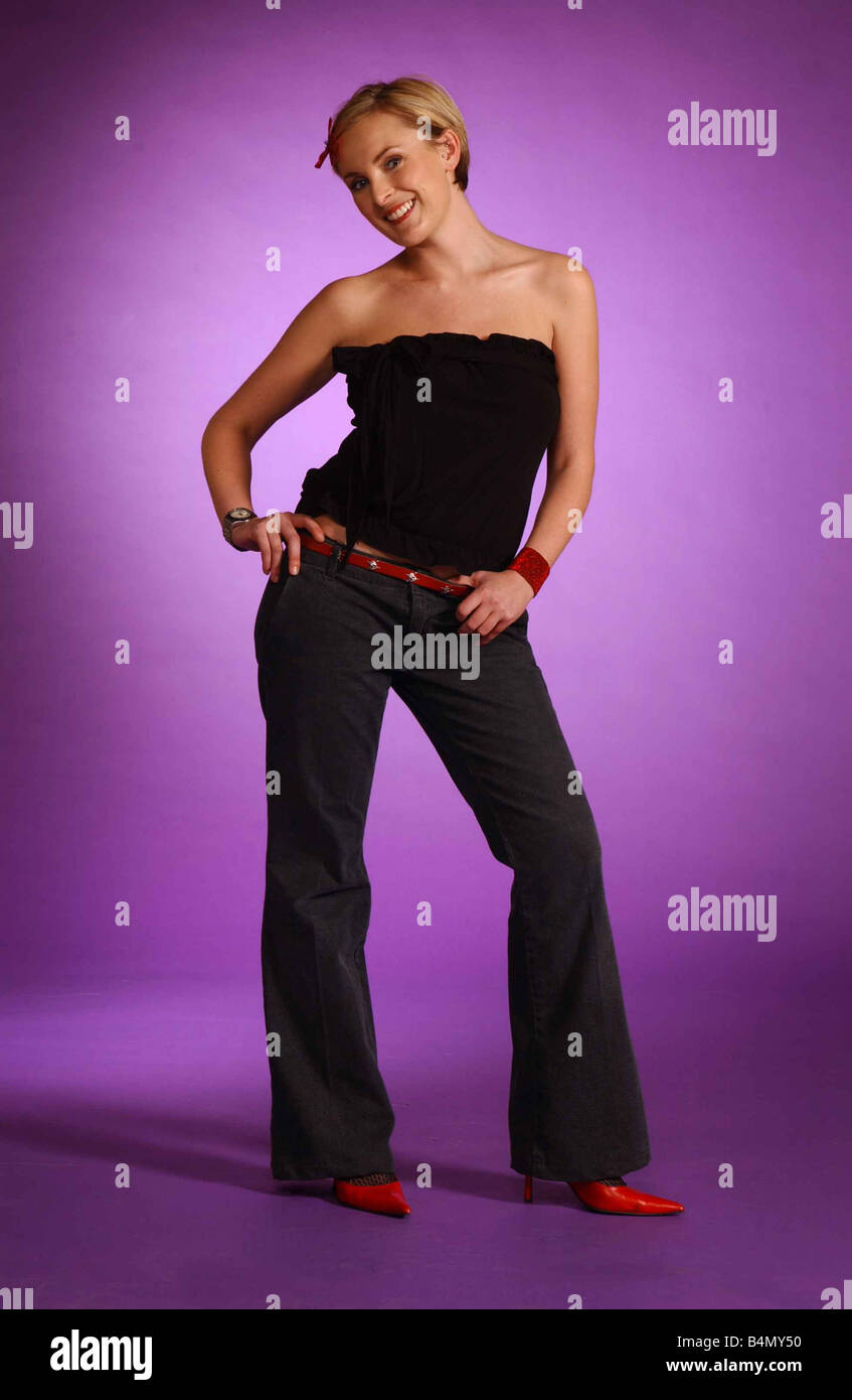 Heather Suttie Radio and TV Presenter December 2002 Jeans strapless top red shoes belt - Stock Image