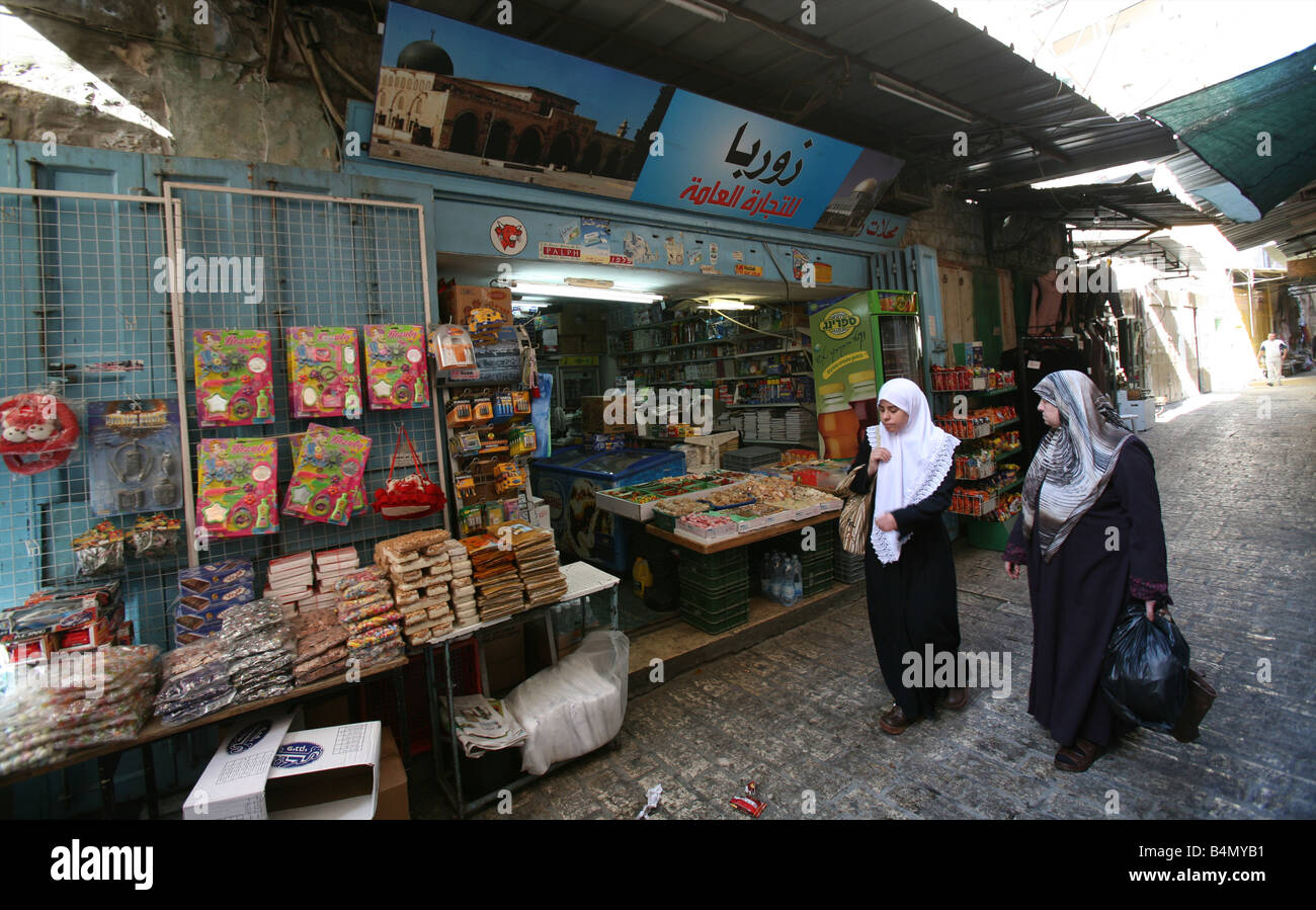 Muslim women at a market in the old city section of Jerusalem - Stock Image