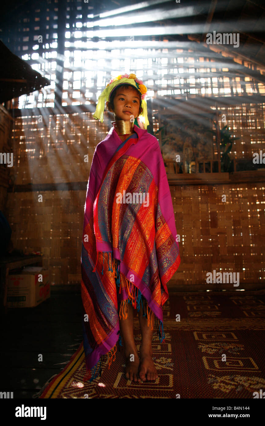 Portrait of a Longneck girl in traditional dress Approximately 300 Burmese refugees in Thailand are members of the - Stock Image