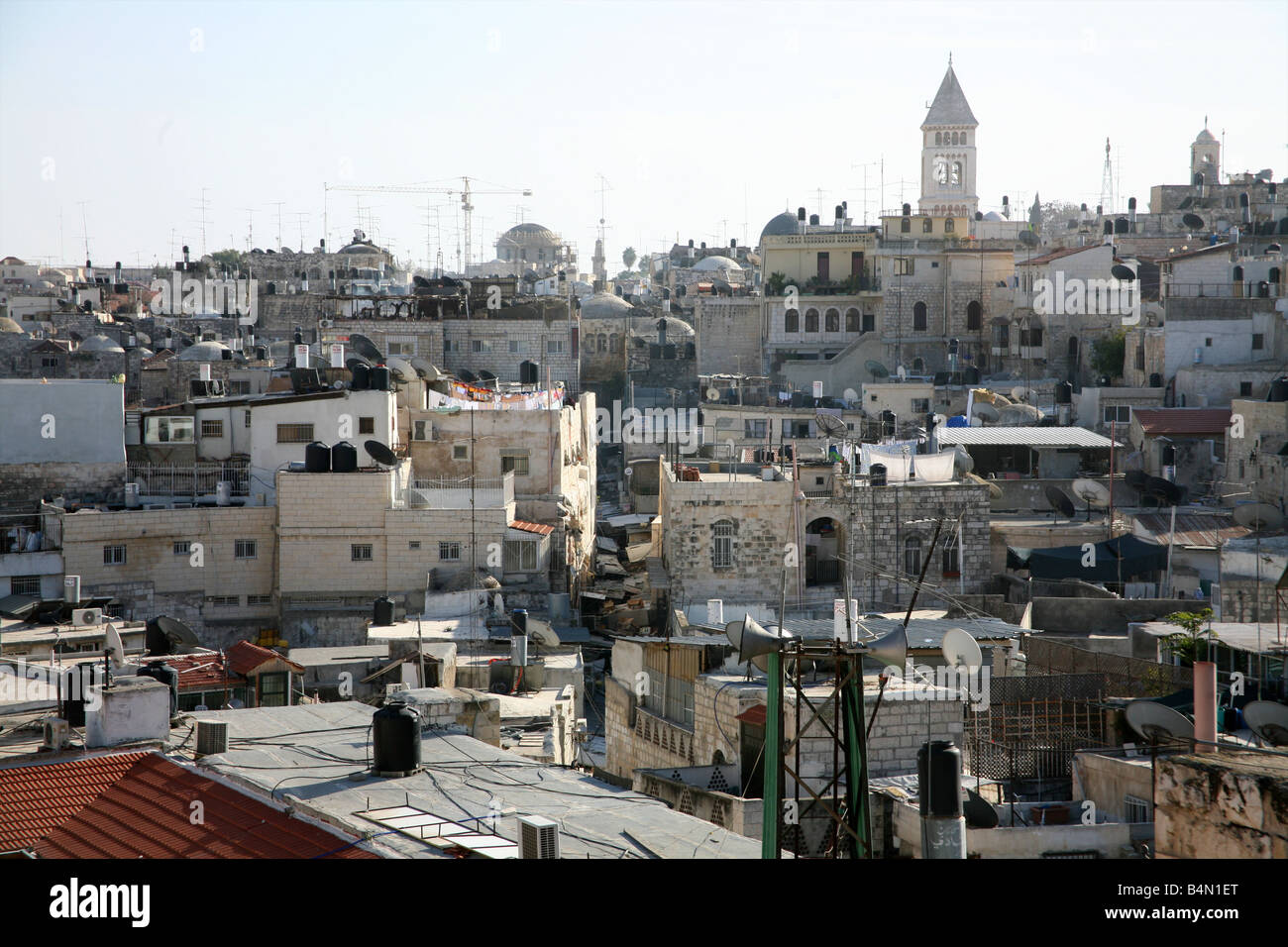 Urban skyline full of chimneys and communications equipment in the old city section of Jerusalem - Stock Image